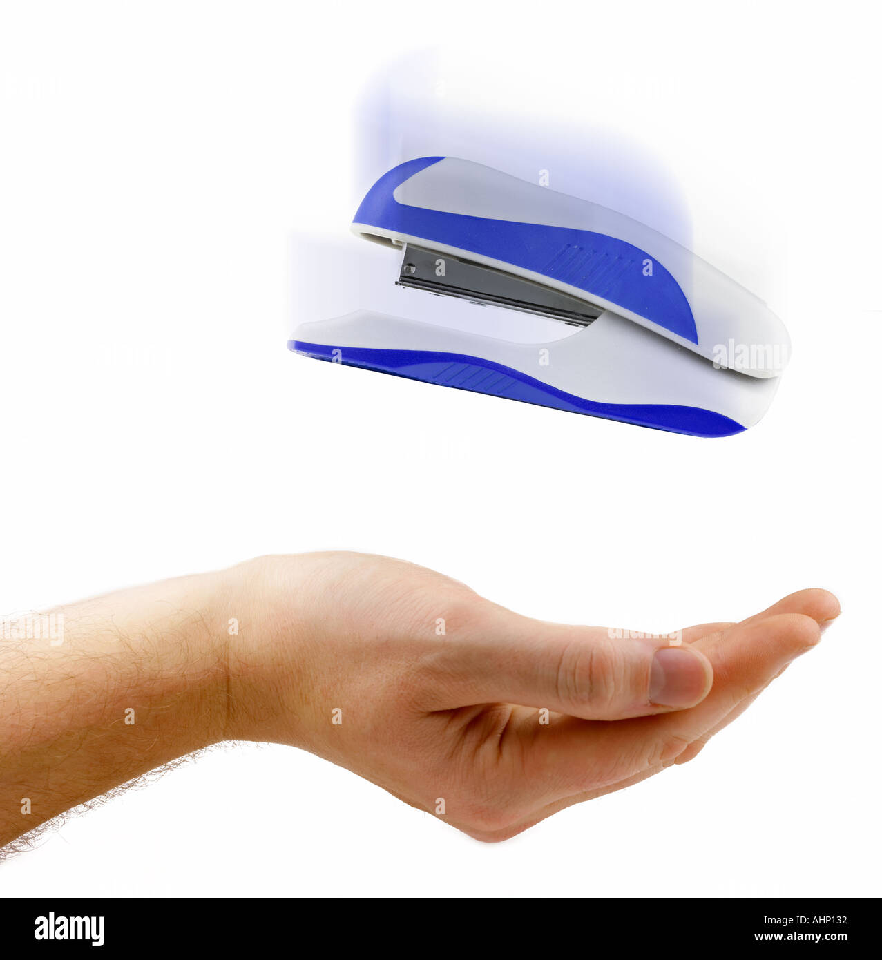 Office Stapler Falling into Hand Workplace theft Concept - Stock Image