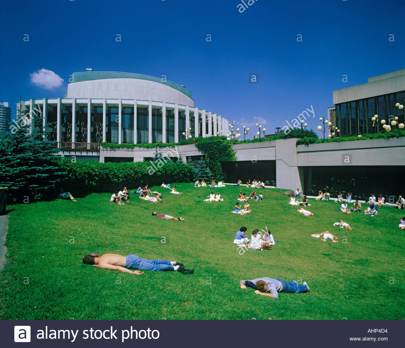 Lunchtime nap at Place Des Arts concert hall in Montreal Quebec Canada - Stock Image