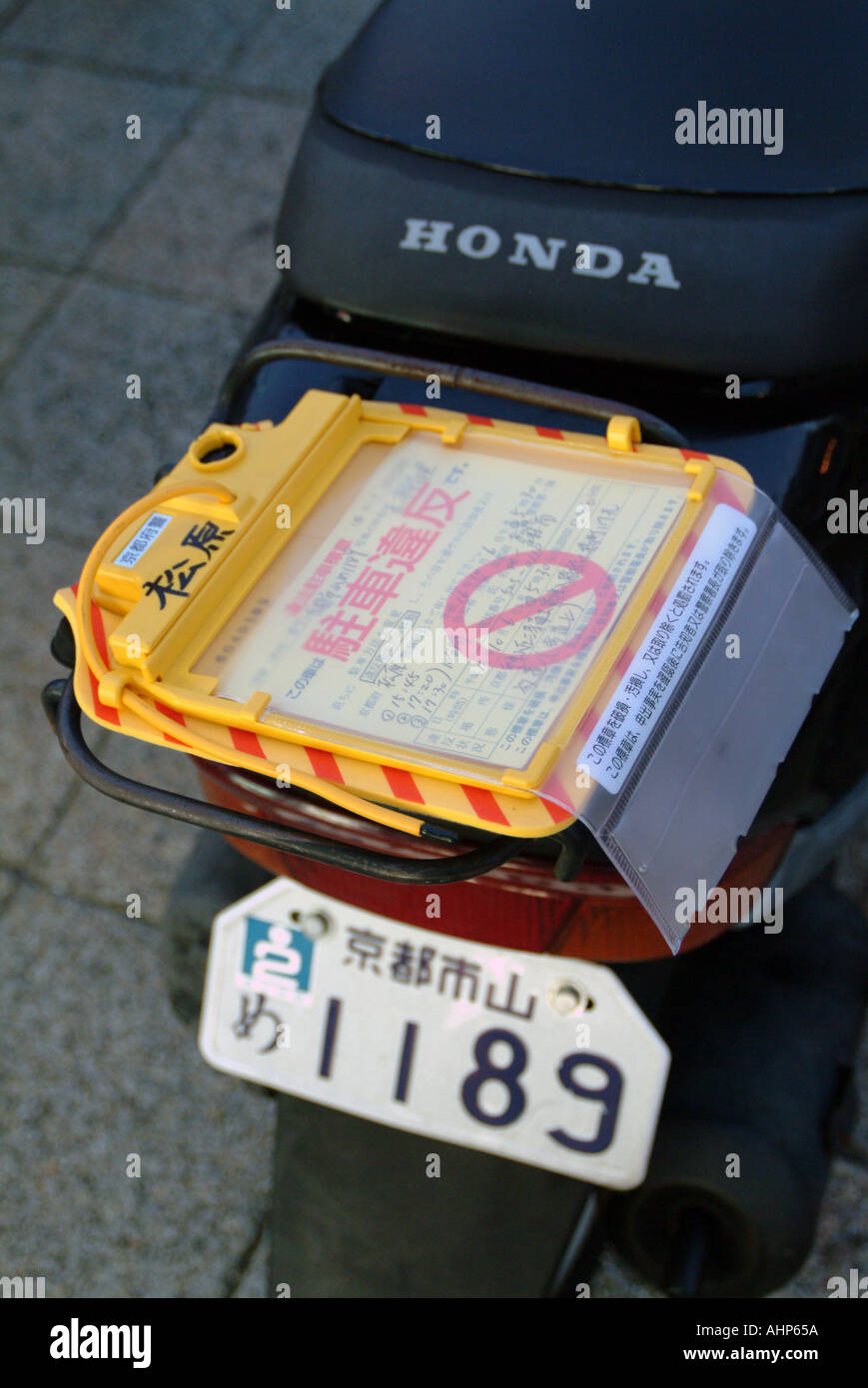 Parking ticket on a scooter Kyoto Japan - Stock Image
