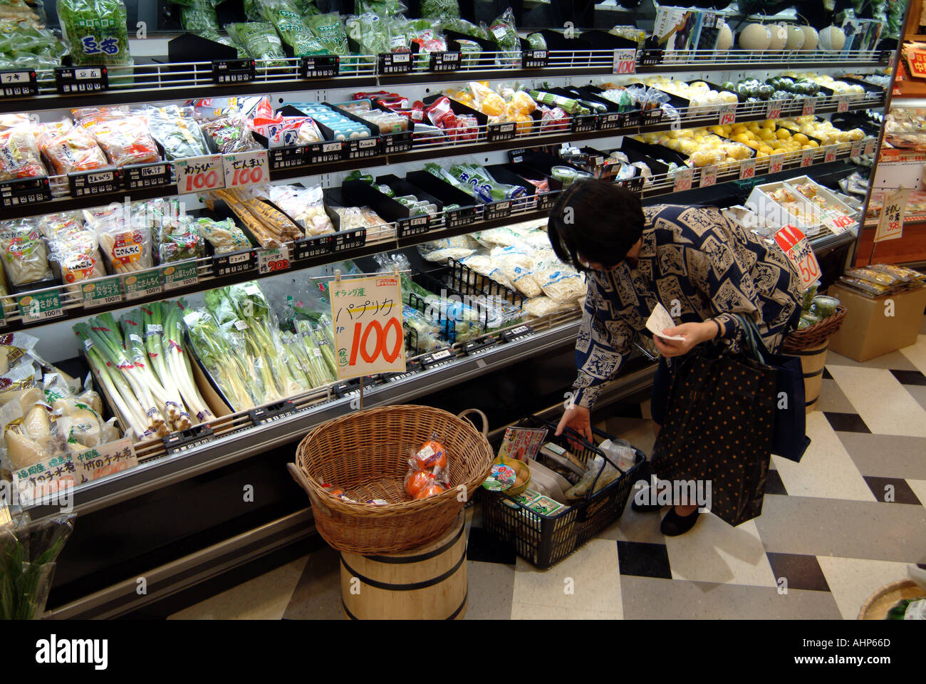 Woman shopping in a supermarket Kyoto Japan - Stock Image