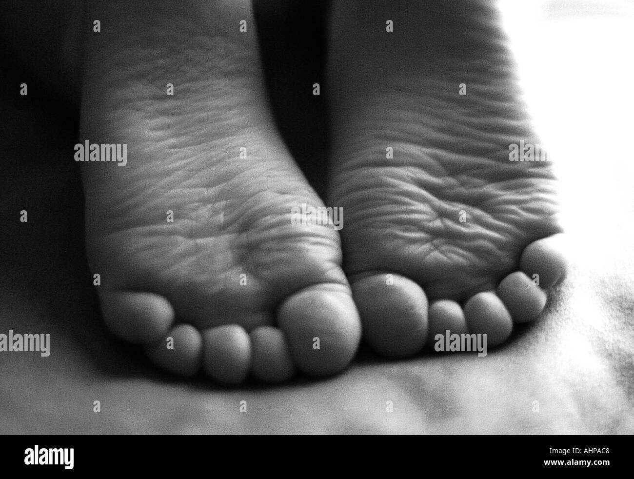 Child s feet and toes bottom view - Stock Image