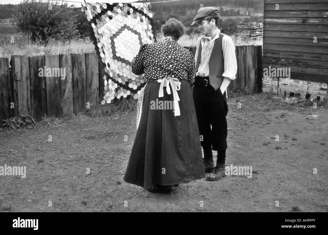 Man and woman dressed in period costume at the open air museum at Beamish. - Stock Image
