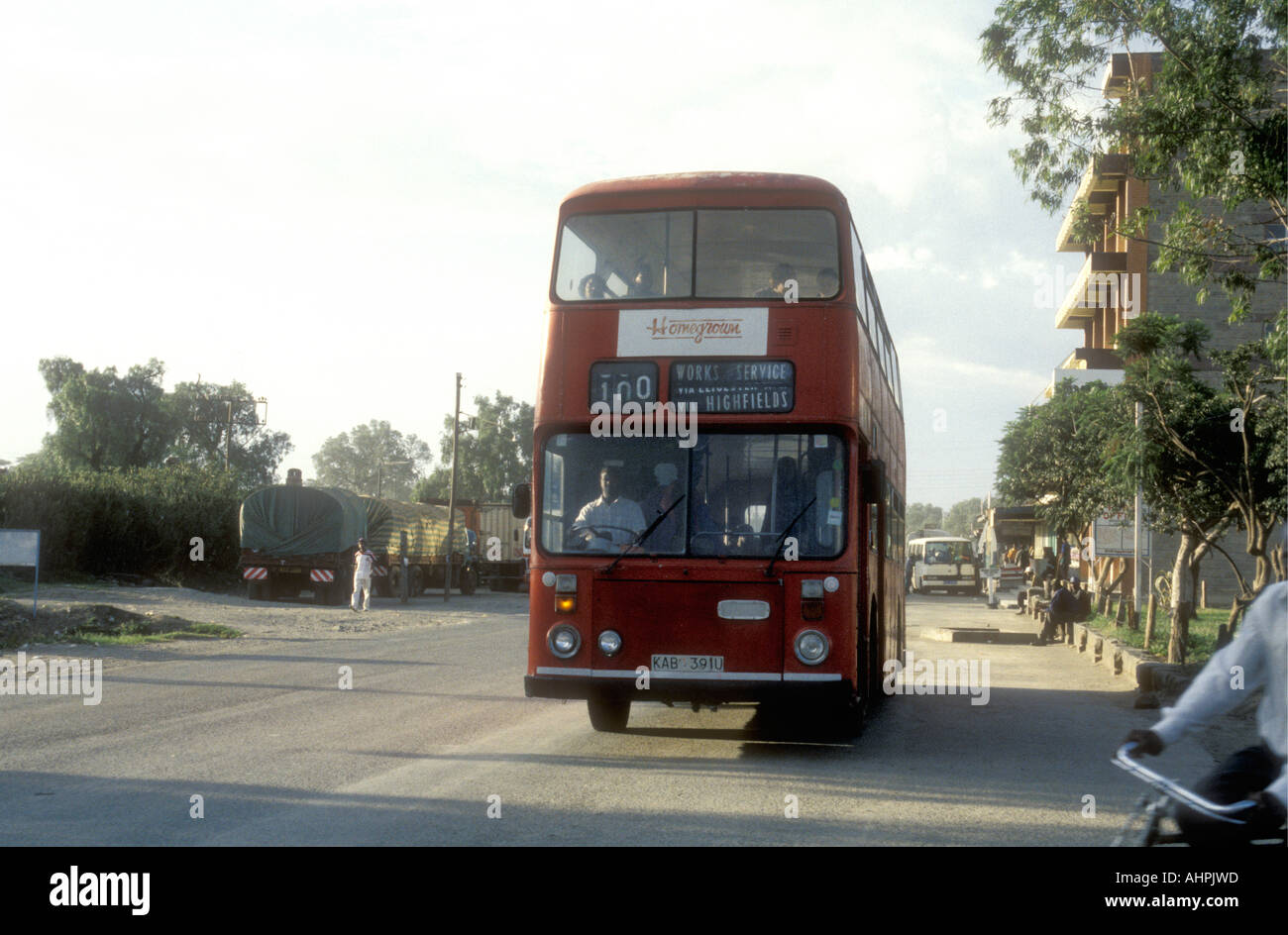 British style red double decker bus used to carry agricultural workers to work in Naivasha Kenya East Africa - Stock Image