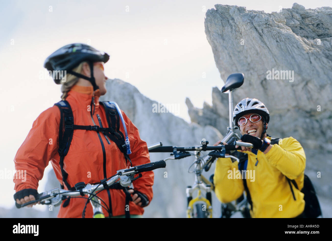 Mountain bikers face to face - Stock Image