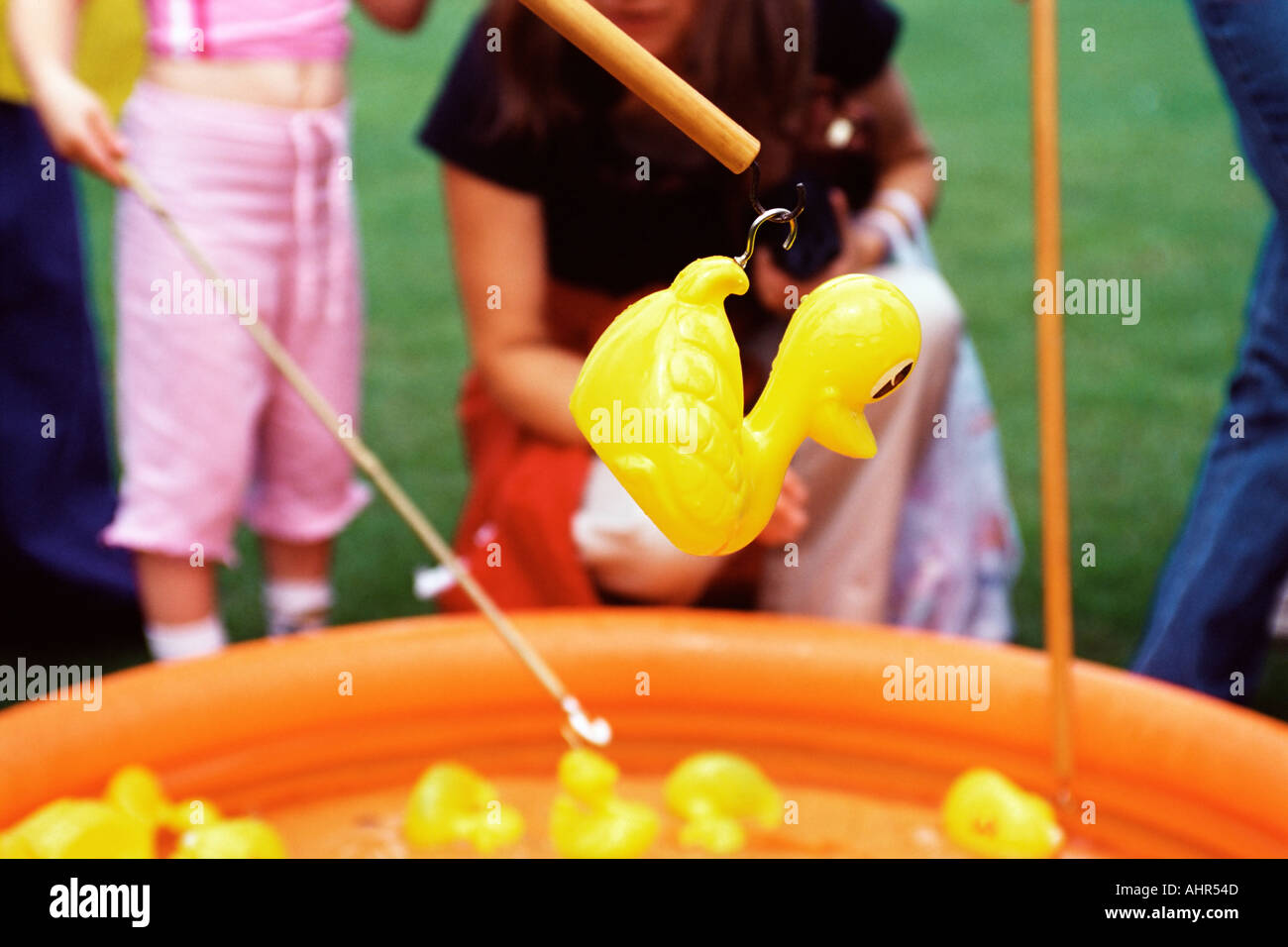 Girl playing game at fete - Stock Image