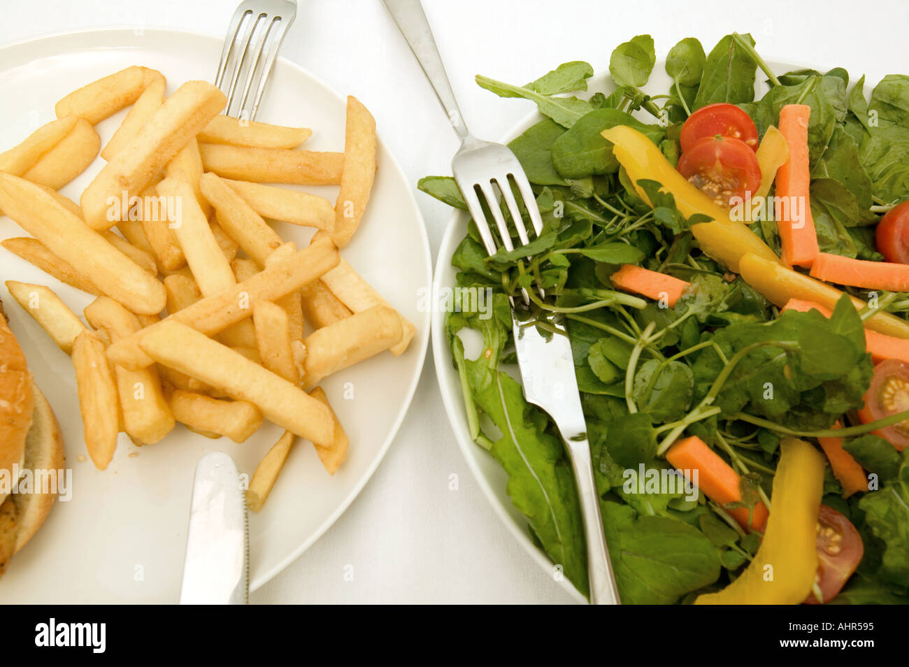 A healthy and unhealthy meal - Stock Image