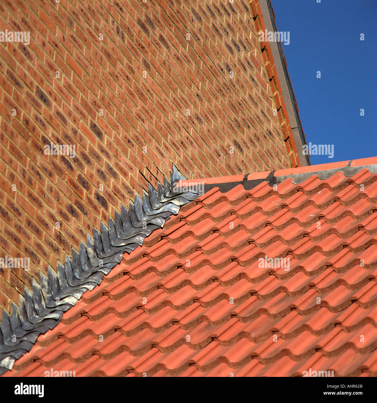 Brick wall and tiled roof - Stock Image