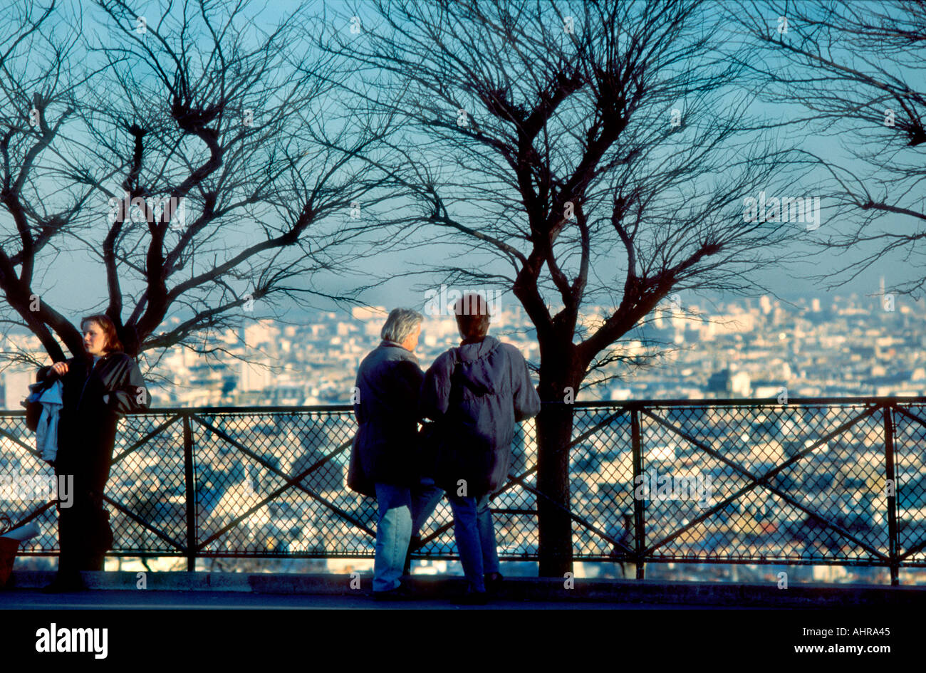 Paris France, Montmartre Skyline View With Couple in Silhouette Looking at Overview city aerial people - Stock Image