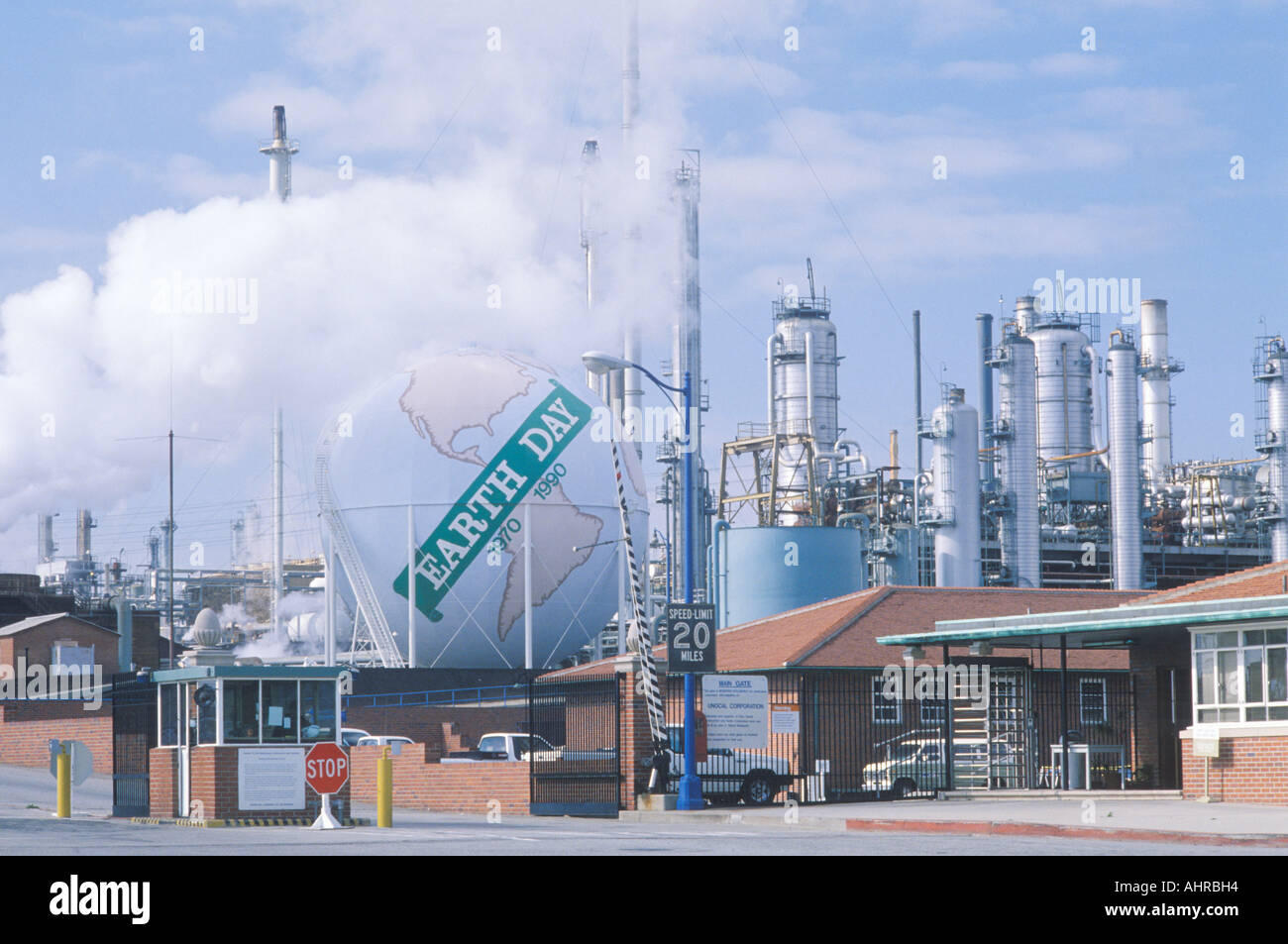 Tank painted as a globe with the words Earth Day 1970 1990 at a Unocal oil refinery in Los Angeles CA - Stock Image