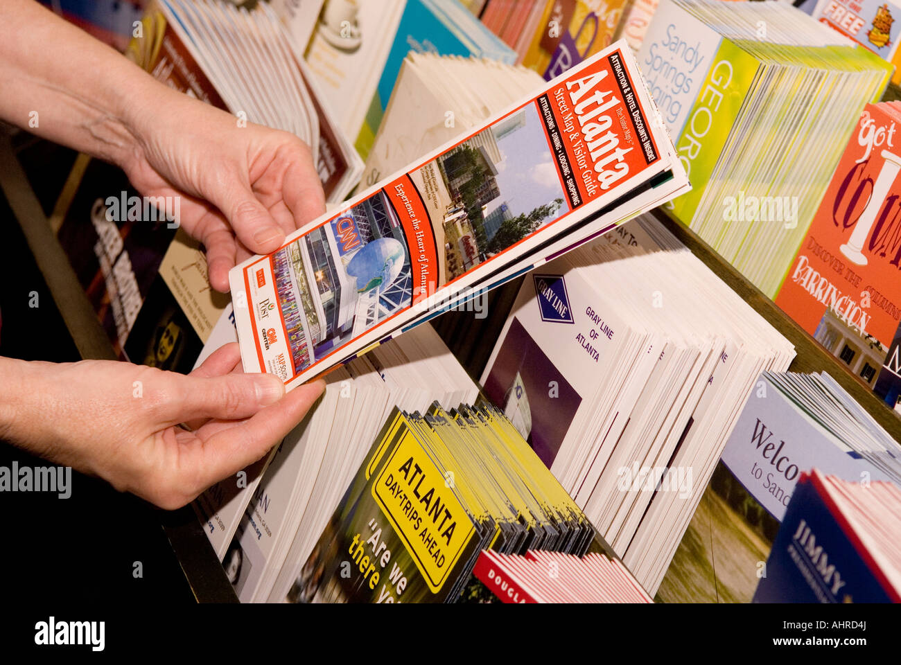 Caucasian Woman Holding Atlanta Brochure GA - Stock Image