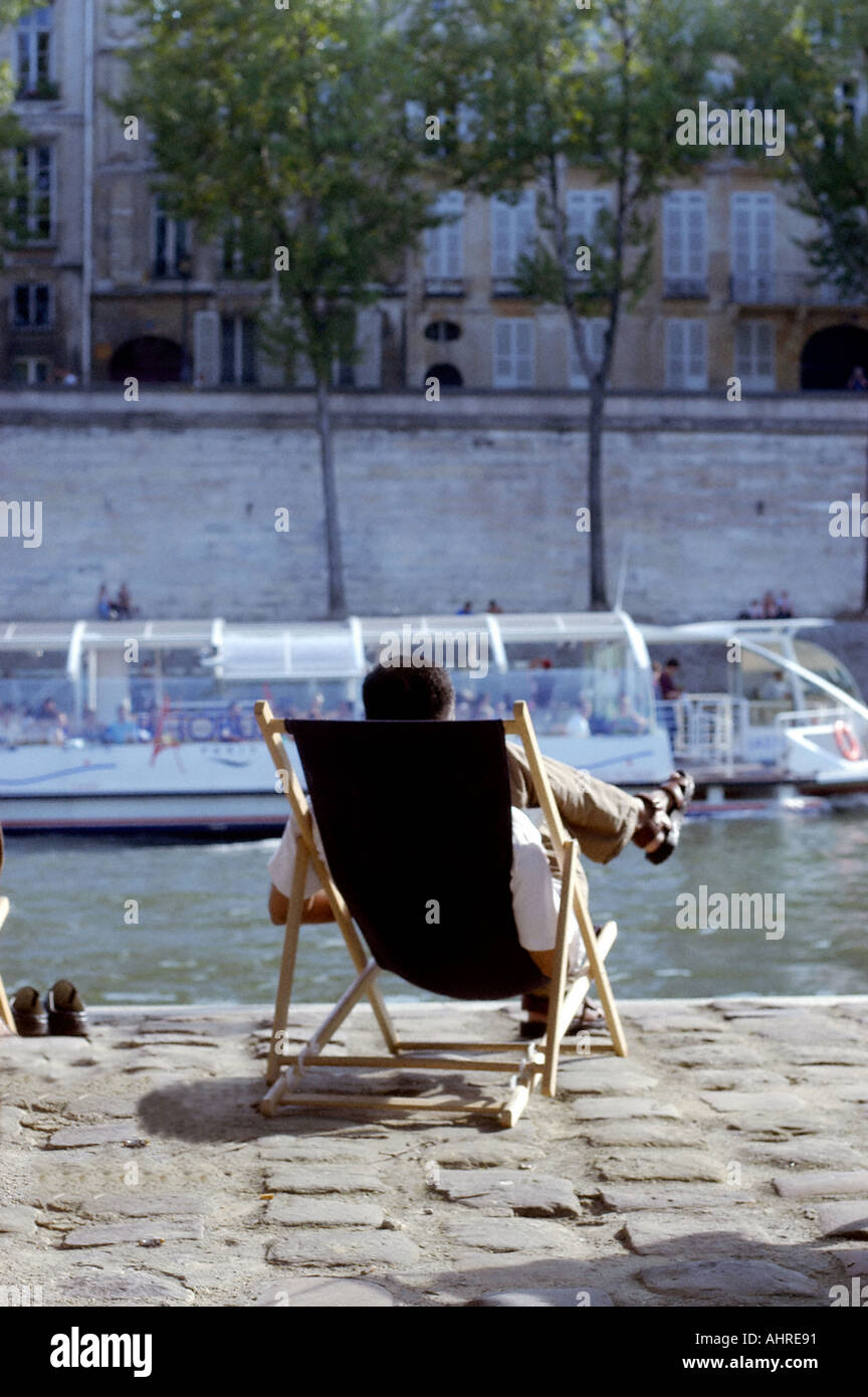 PARIS France Festivals in France, 'Paris Plages' on Seine River Man Relaxing in Lounge Chair River Seine, adult extracurricular activities - Stock Image