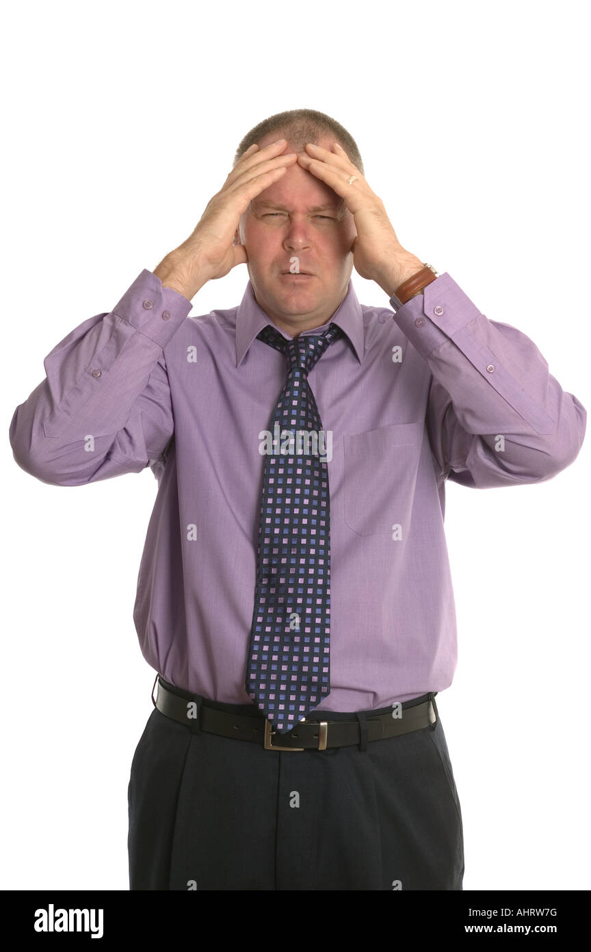 Businessman with a stressful expression on his face Stock Photo