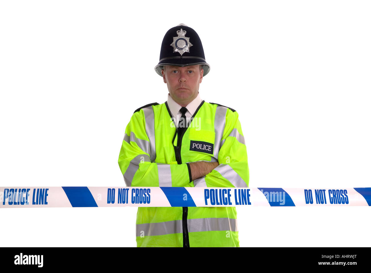 British Police officer standing behind some cordon tape Focus is on the tape - Stock Image