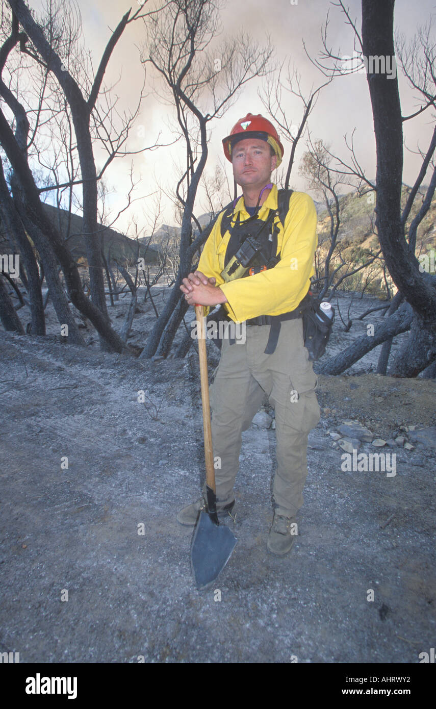 Forest fire fighter holding shovel Los Angeles Padres National Forest California Stock Photo