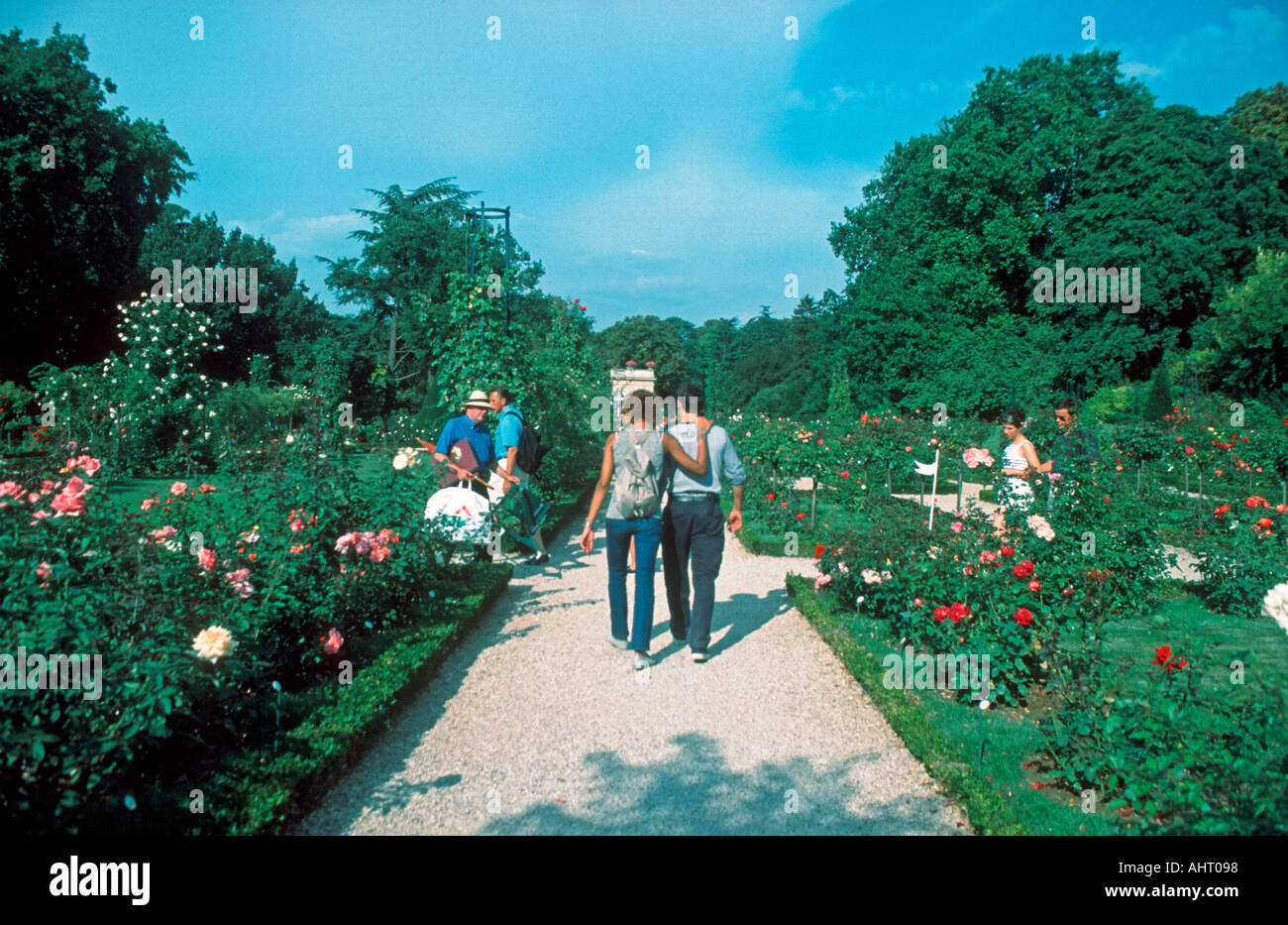 "Paris France, Parks Young Couple Walking in Park, ""Bagatelle Gardens"" in Bois de Boulogne Stock Photo"