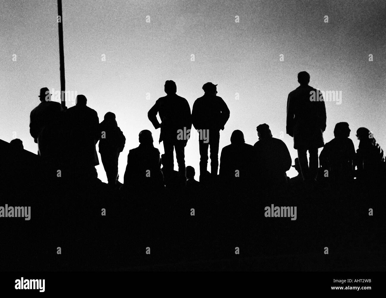 football, Bundesliga, 1970/1971, Niederrhein Stadium in Oberhausen, Rot-Weiss Oberhausen versus FC Bayern Munich 0:4, floodlights match, football fans, backlight, silhouette - Stock Image