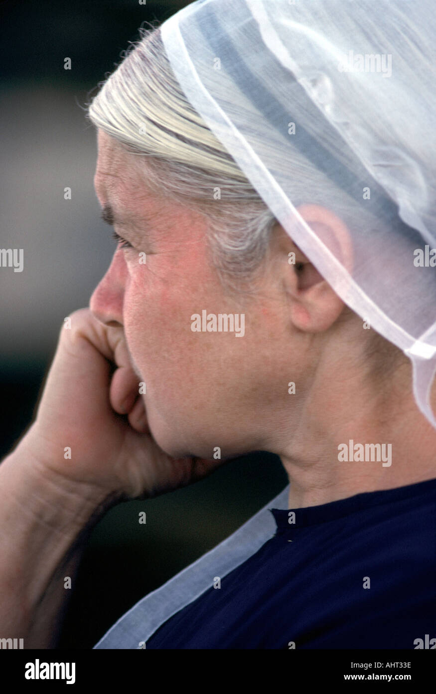 Portrait of a Senior Mennonite female sits in contemplation - Stock Image