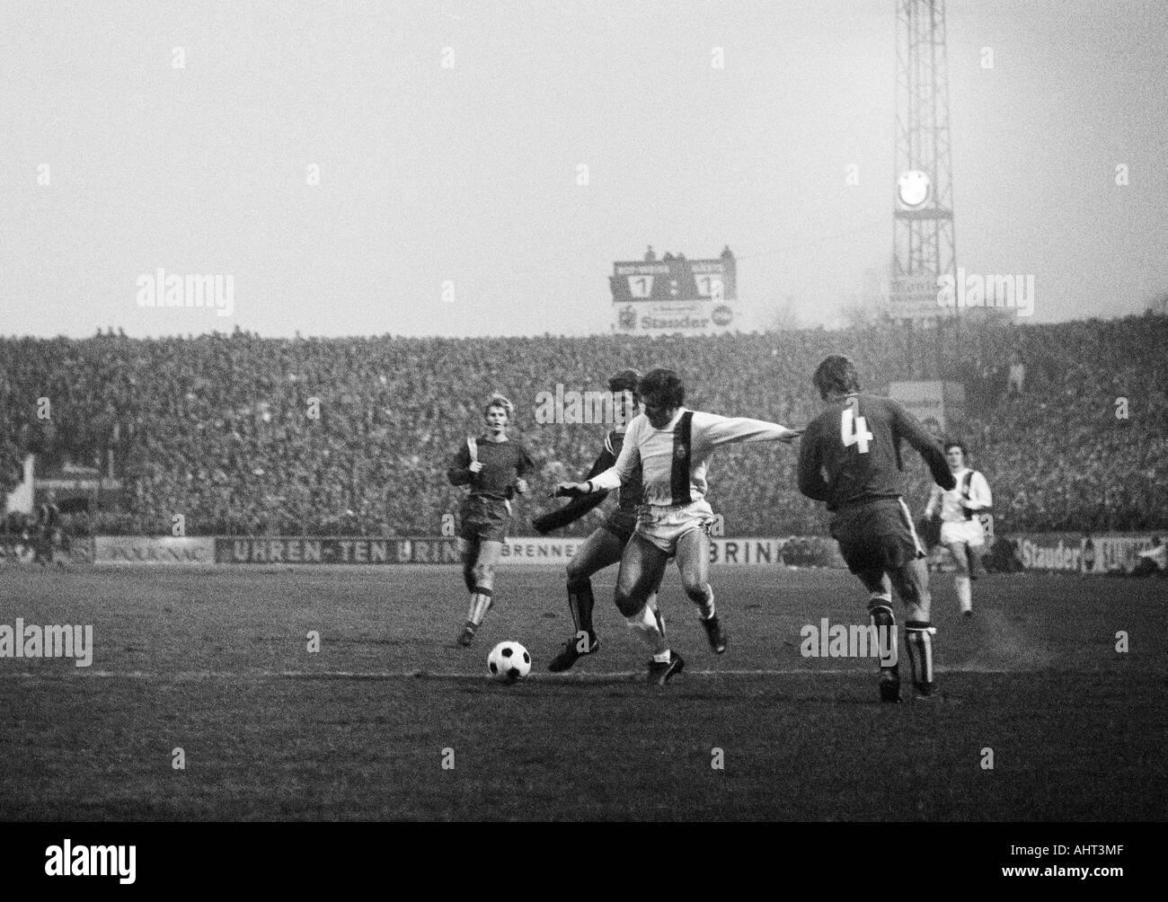 football, Bundesliga, 1970/1971, Stadium at the Hafenstrasse in Essen, Rot-Weiss Essen versus Borussia Moenchengladbach 1:2, scene of the match, f.l.t.r. Peter Czernotzky, Hermann Erlhoff (both RWE), Jupp Heynckes (MG), Wolfgang Rausch (RWE) - Stock Image