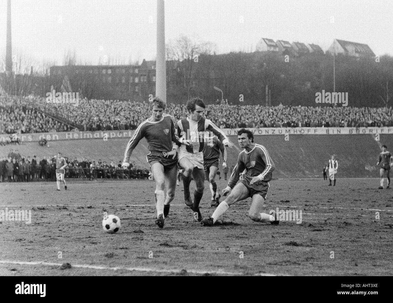 football, Regionalliga West, 1970/1971, Stadium am Zoo in Wuppertal, Wuppertaler SV versus VfL Bochum 2:1, scene of the match, f.l.t.r. Manfred Ruesing (VfL), Gustav Jung (WSV), Erwin Galeski (VfL) - Stock Image