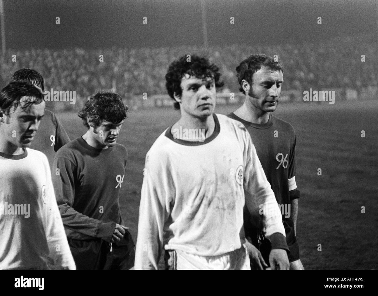 football, Bundesliga, 1970/1971, Niederrhein Stadium, Rot-Weiss Oberhausen versus Hanover 96 4:3, football players leaving the pitch, f.l.t.r. Dieter Brozulat (RWO), Rainer Stiller (96), Reiner Hollmann (RWO), Hans Siemensmeyer (96) - Stock Image