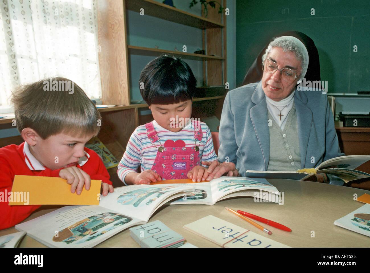 catholic school setting nun teacher works with asian american girl