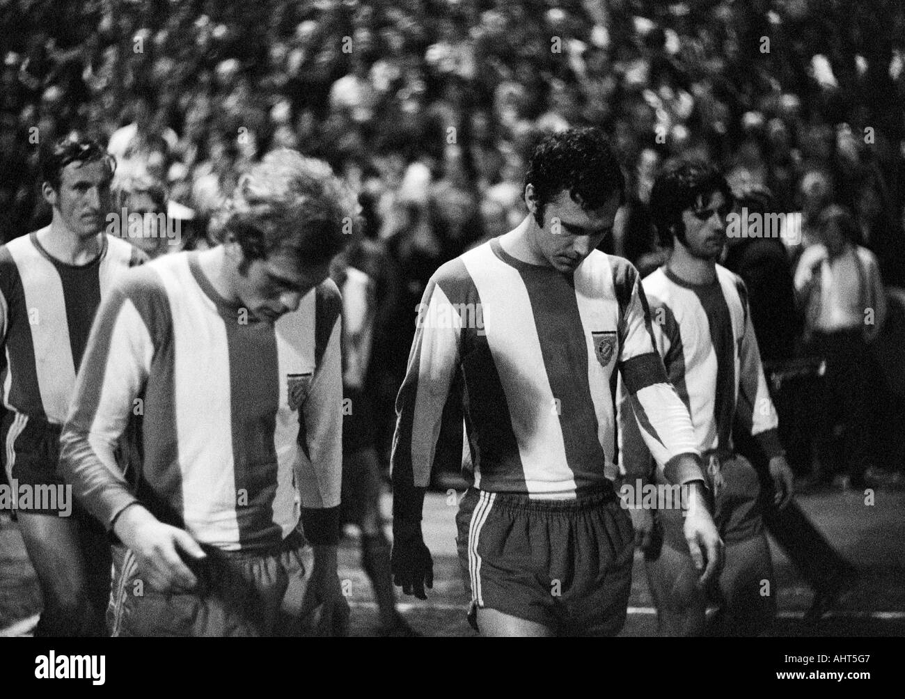 football, Bundesliga, 1970/1971, Boekelberg Stadium in Moenchengladbach, Borussia Moenchengladbach versus FC Bayern Munich 3:1, football players coming in, f.l.t.r. Georg Schwarzenbeck, Ulrich Hoeness, Franz Beckenbauer, Gerd Mueller (all FCB) - Stock Image