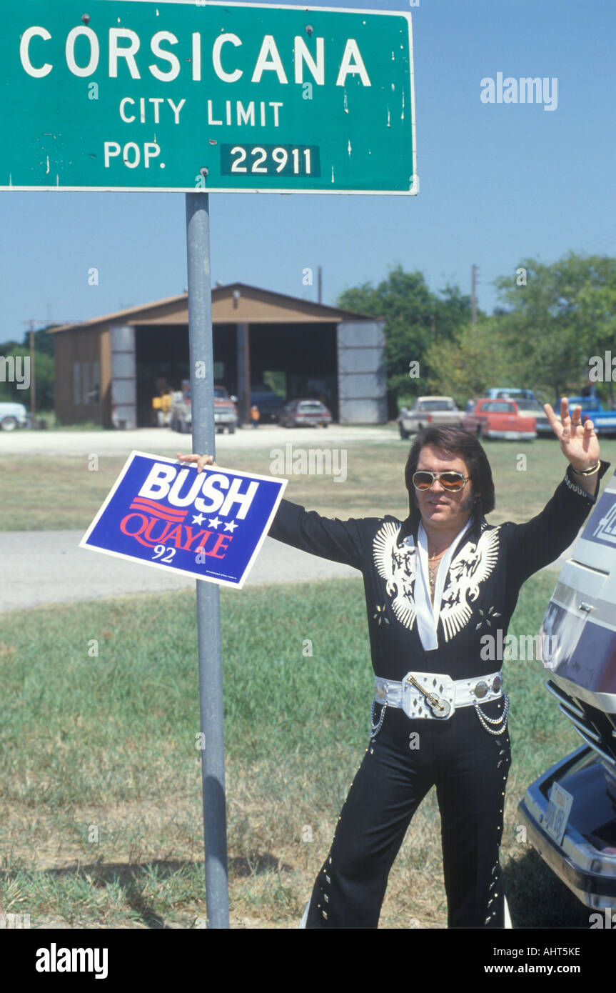 Elvis look alike holds a Bush Quayle sign during the Clinton Gore 1992 Buscapade campaign tour in Corsicana Texas - Stock Image