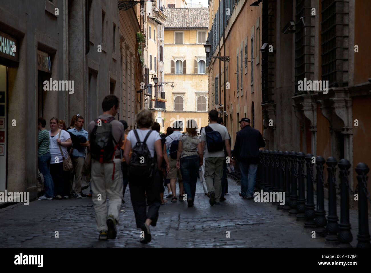 tourists walk down narrow back streets in the old city Rome Lazio Italy - Stock Image