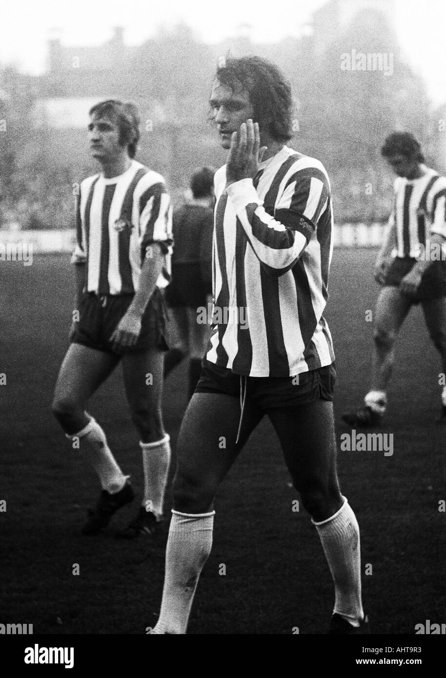 football, Bundesliga, 1971/1972, VfL Bochum versus 1. FC Cologne 1:5, Stadium at the Castroper Strasse in Bochum, football players leaving the pitch, left Hannes Loehr, right Wolfgang Overath (both Koeln) - Stock Image