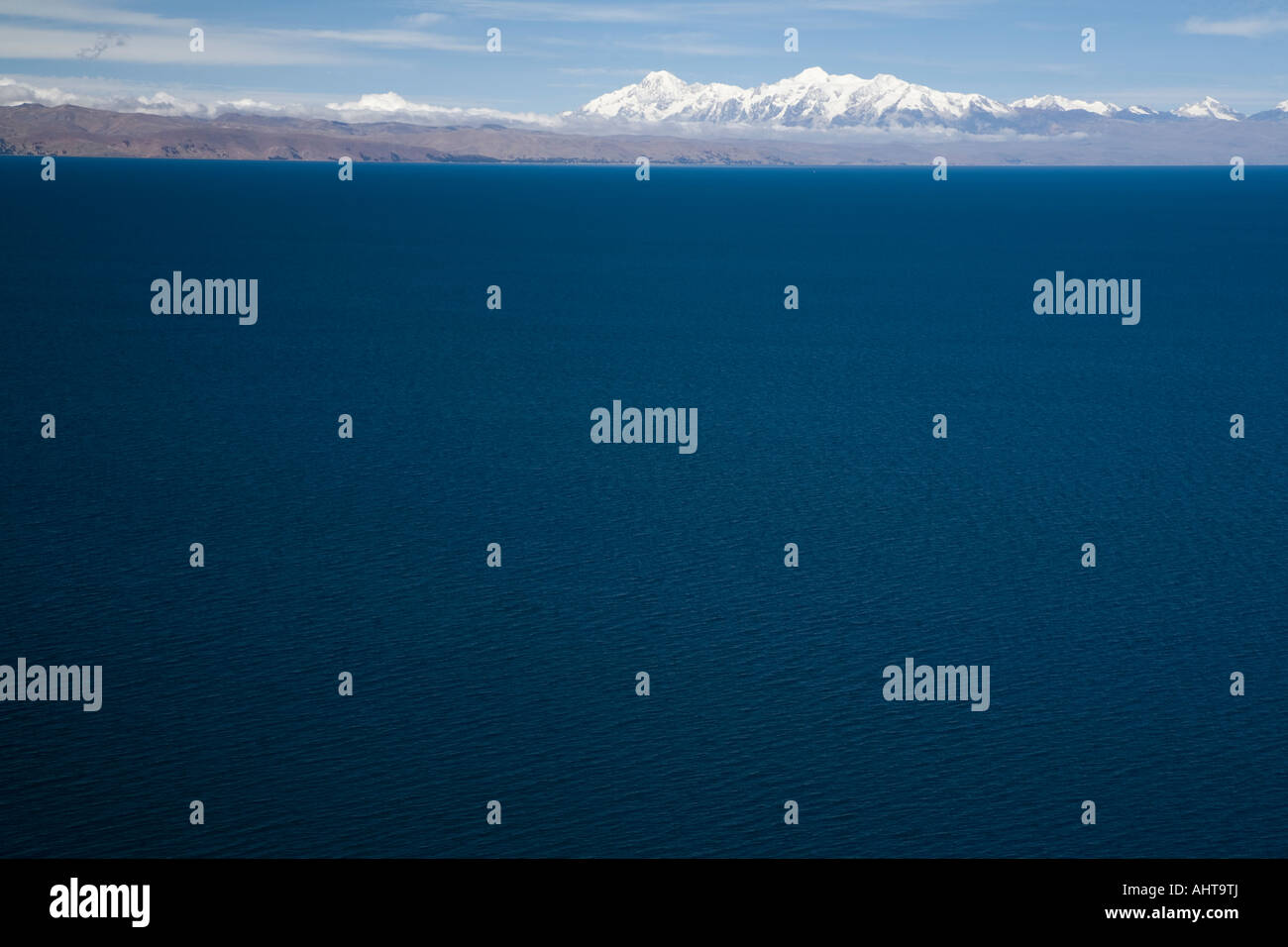 View over the lake to Cordillera Real and Mount Illampu,   across Lake Titicaca - Stock Image