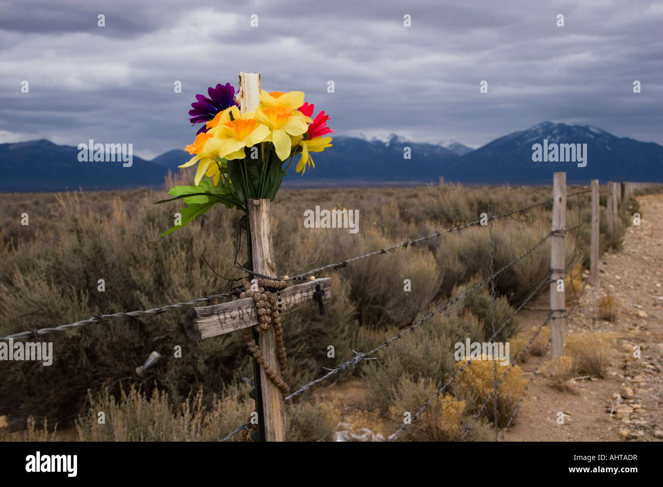 Cross and flowers marking an accidental death Stock Photo