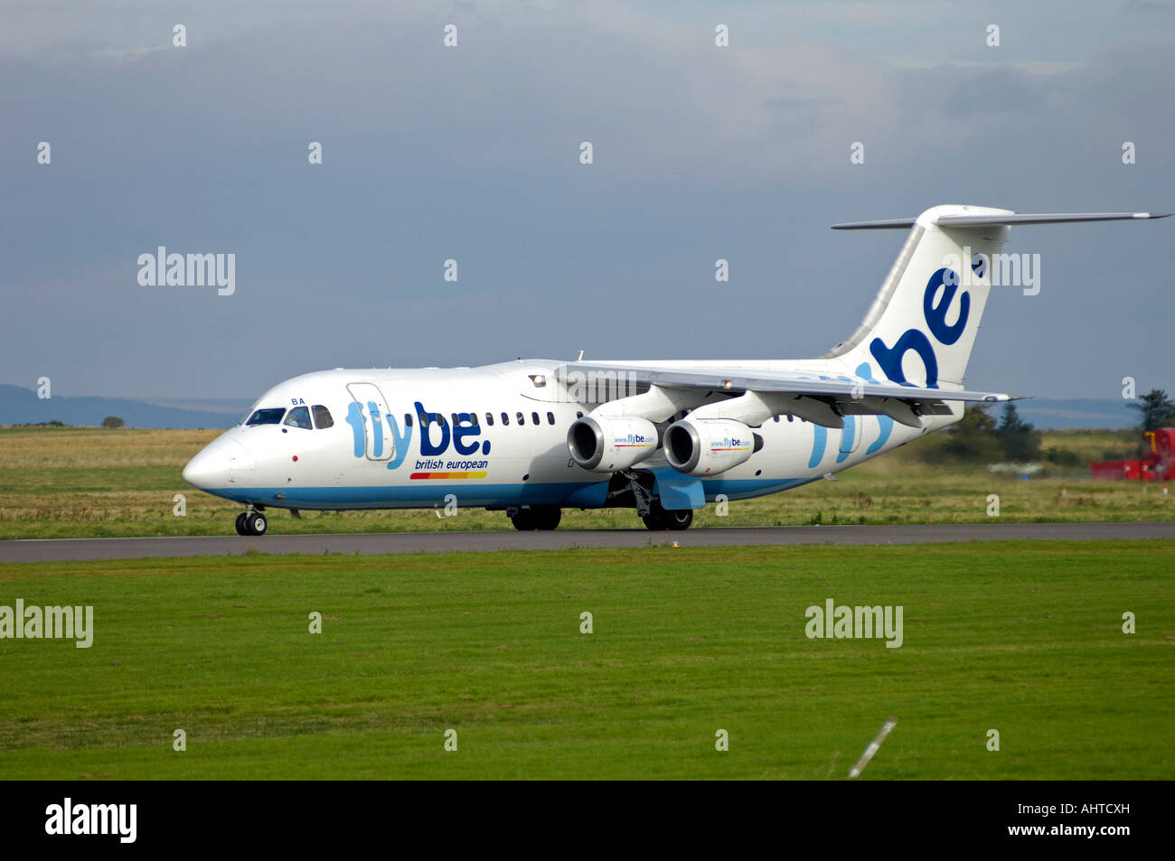Exeter Based Flybe Aircraft- British European British Aerospace BAe-146-300 on Runway Taxi Way - Stock Image