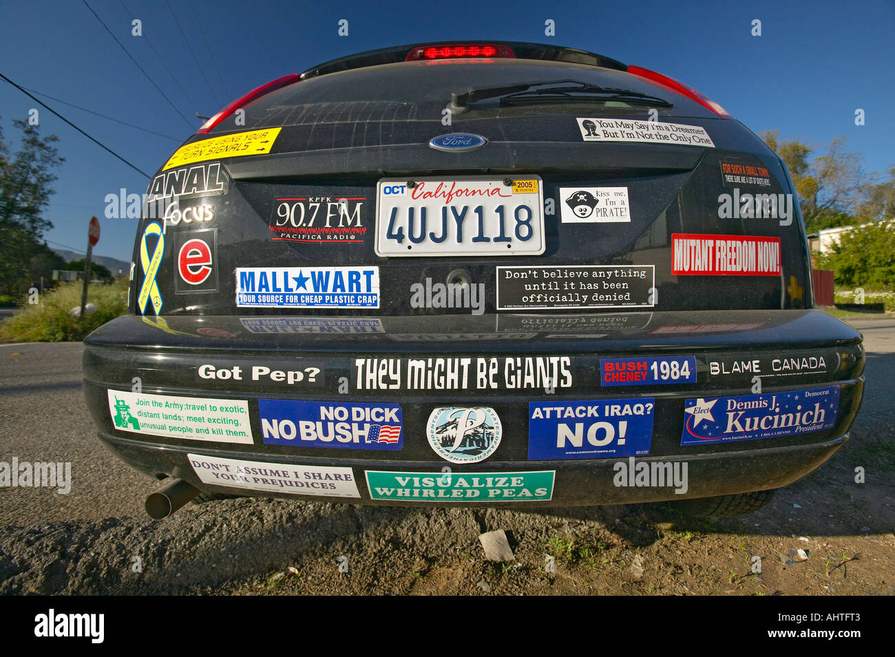 Car with political and social issues bumper stickers in Oak View California - Stock Image