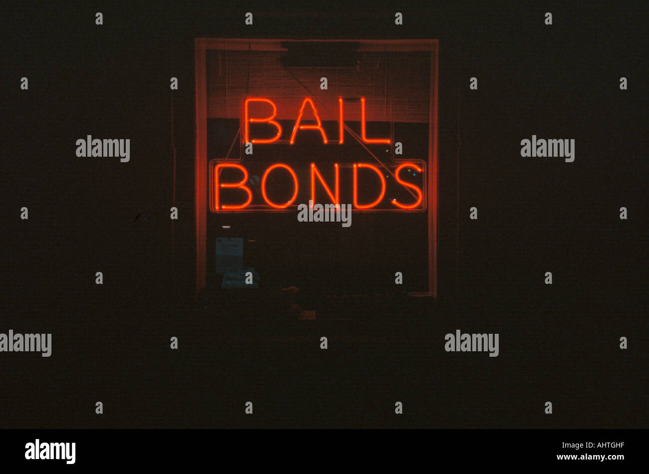 A neon sign that reads Bail Bonds - Stock Image