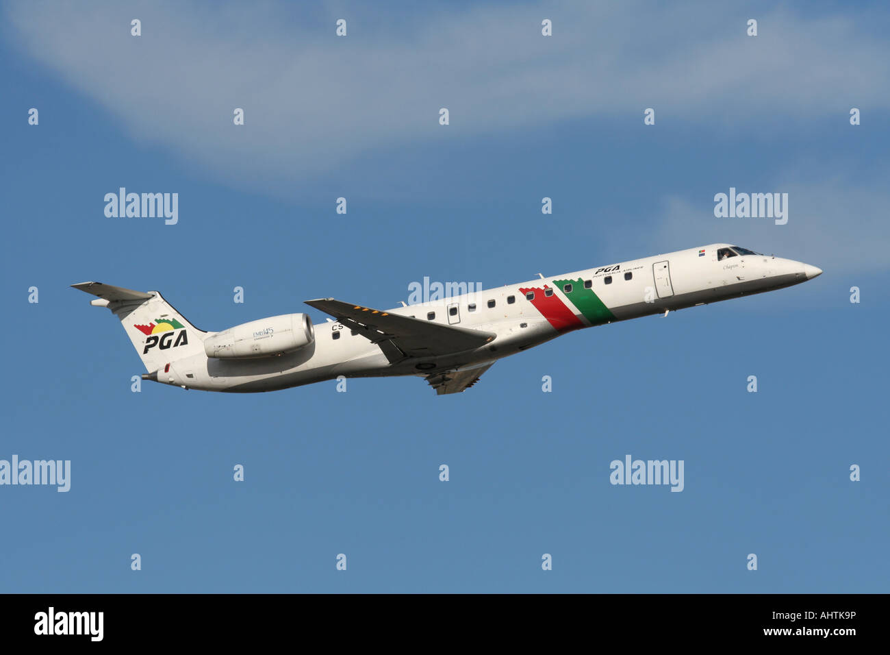 PGA Portugalia Embraer ERJ 145 regional airliner in flight on departure against a blue sky. Short haul air travel. - Stock Image