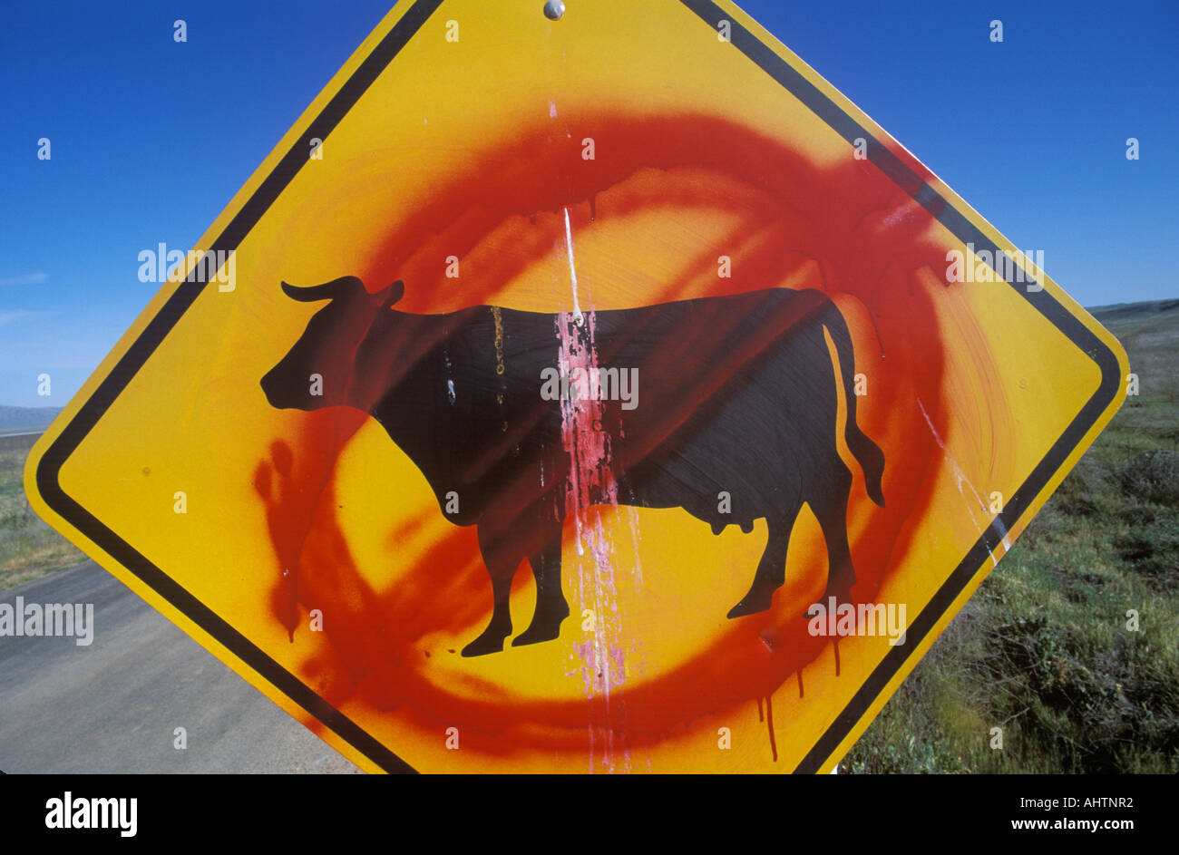 A defaced roadside sign - Stock Image