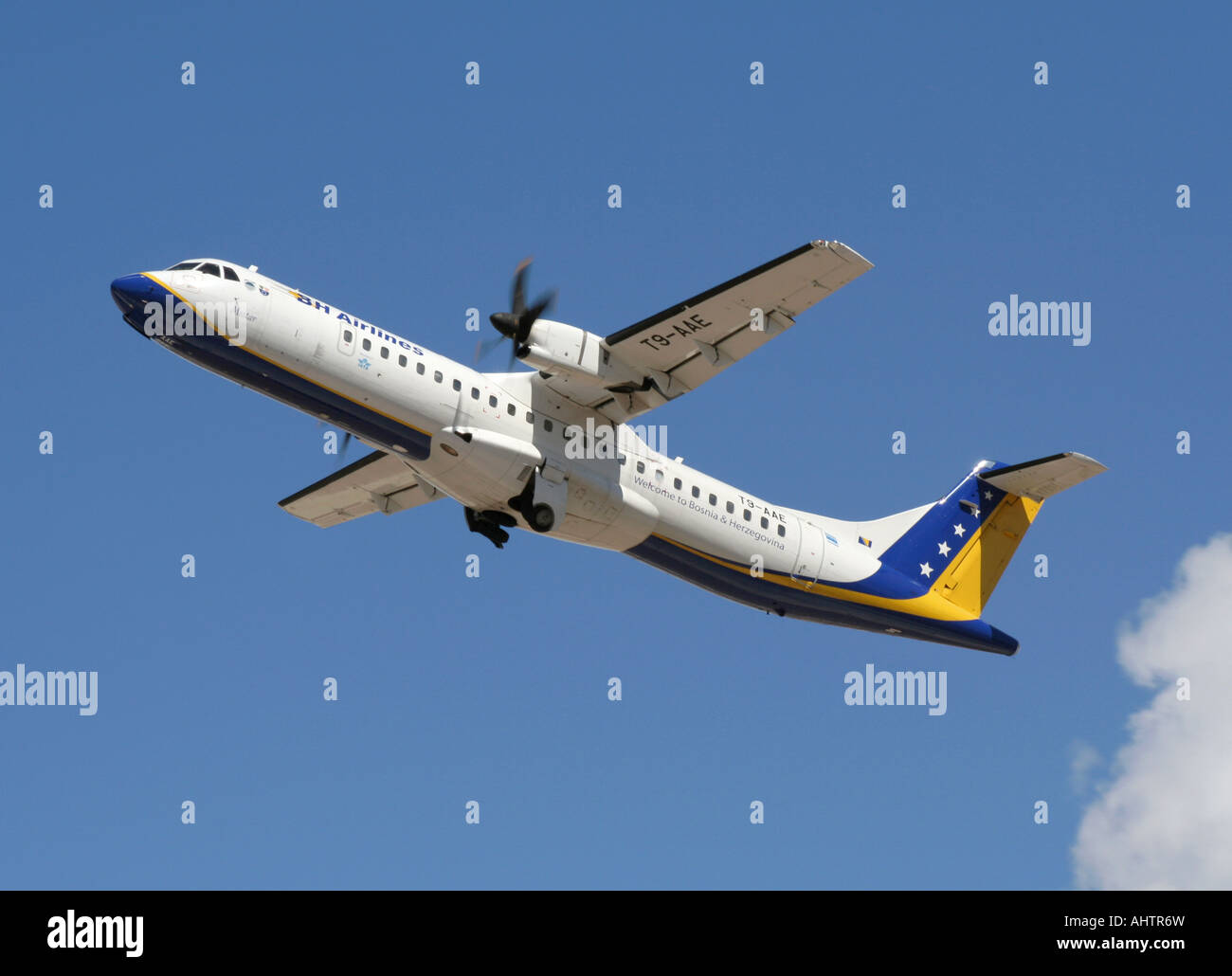 ATR 72-212 short haul turboprop airliner operated by BH Airlines of Boznia-Herzegovina in flight after takeoff - Stock Image