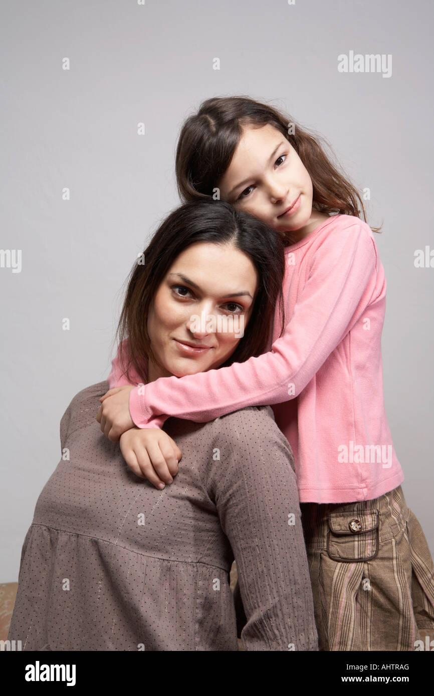 Daughter (5-7)embracing mother, portrait Stock Photo