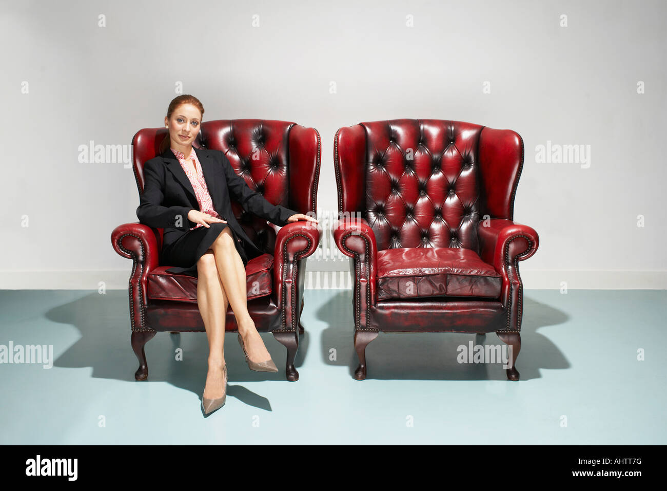 Businesswoman in a comfy leather chair Stock Photo