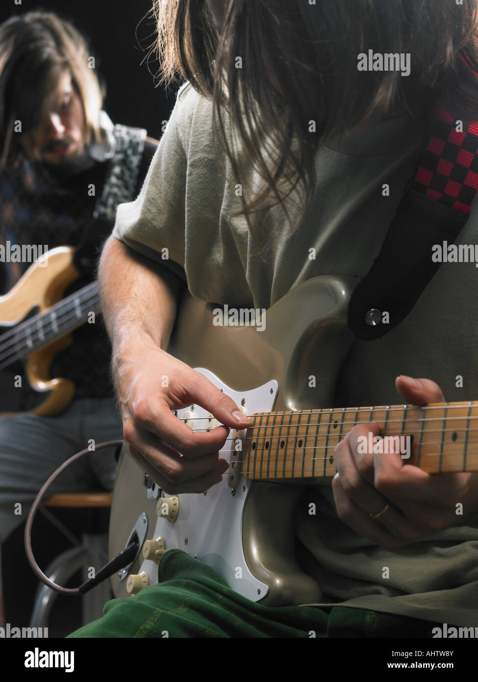 Two electric guitar players. - Stock Image