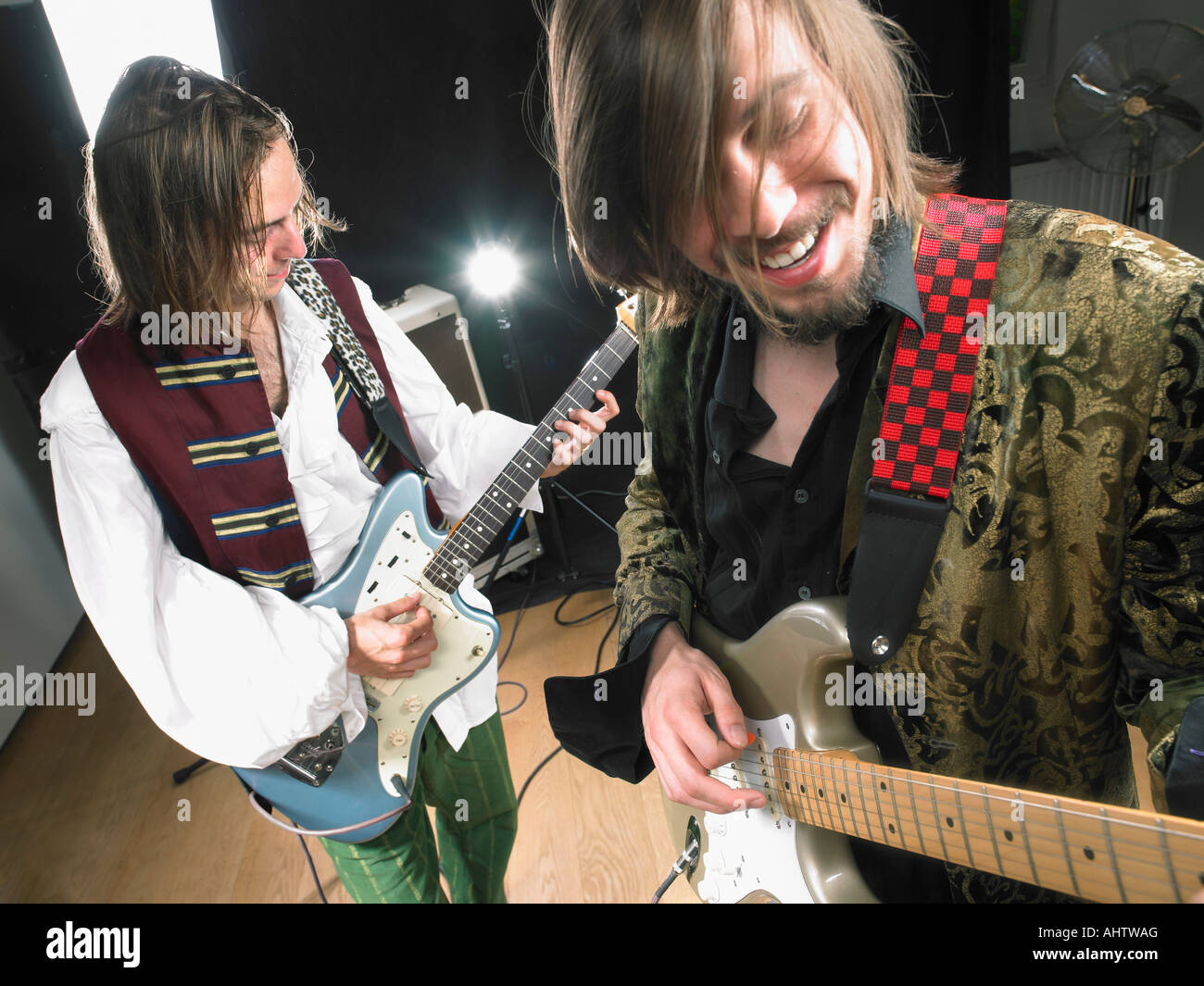 Two electric guitar players in studio. - Stock Image