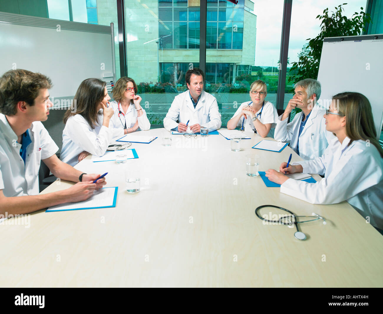 Meeting between a group of doctors. - Stock Image