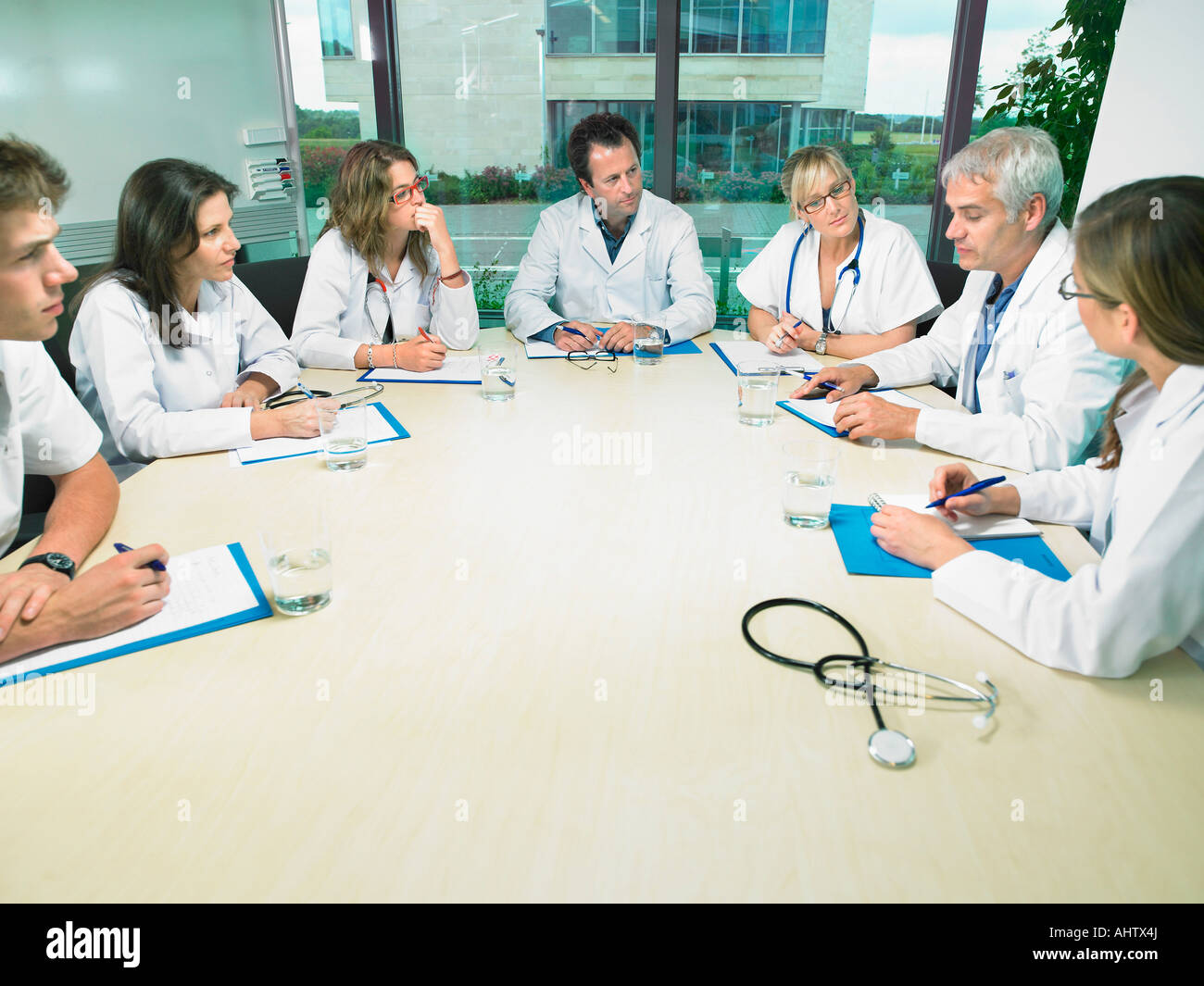 Group of doctors meeting in conference room. - Stock Image