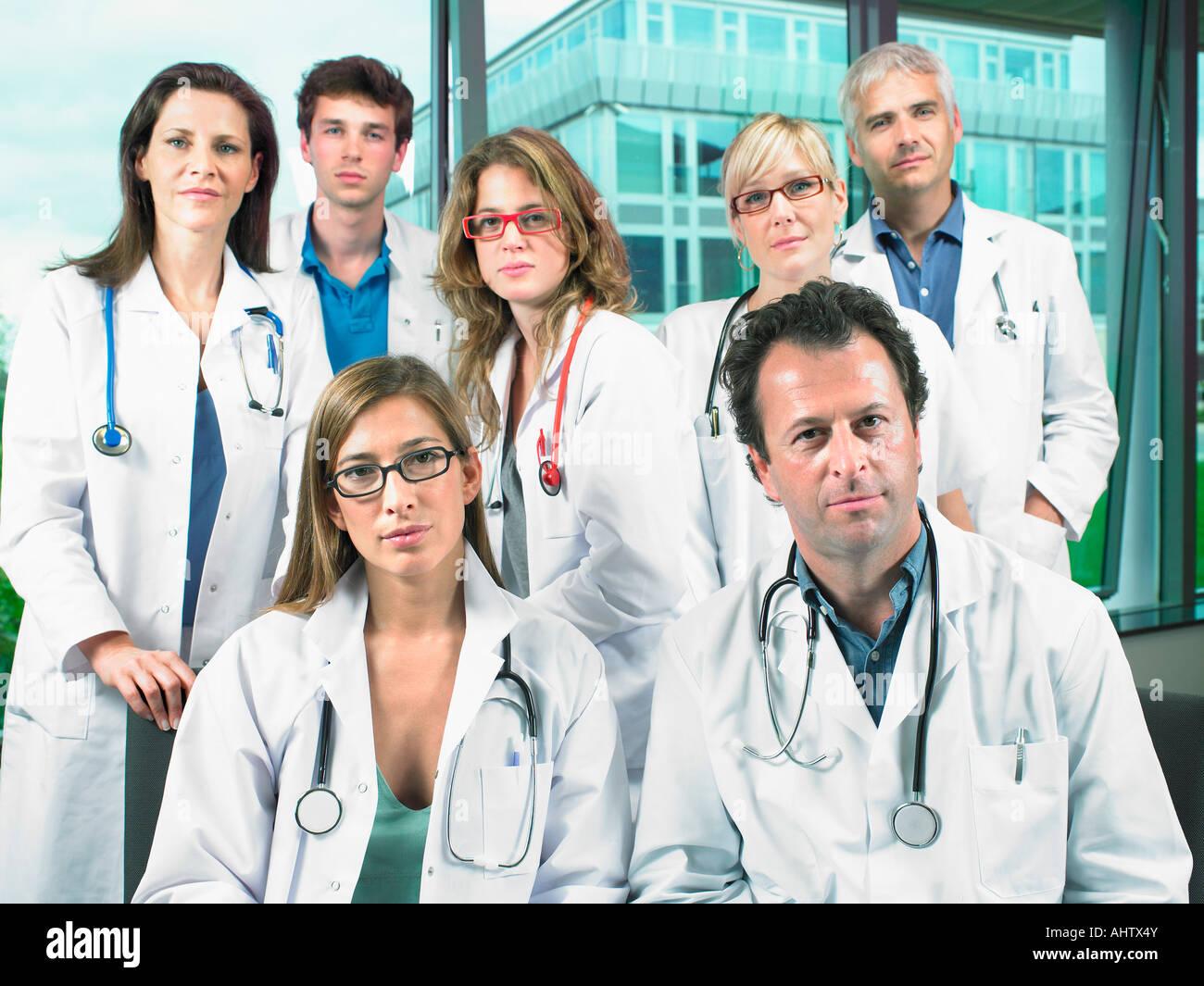 Group portrait of seven doctors. - Stock Image