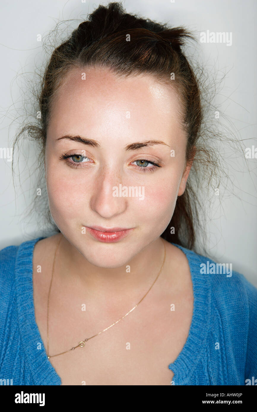 Young female looking downwards - Stock Image