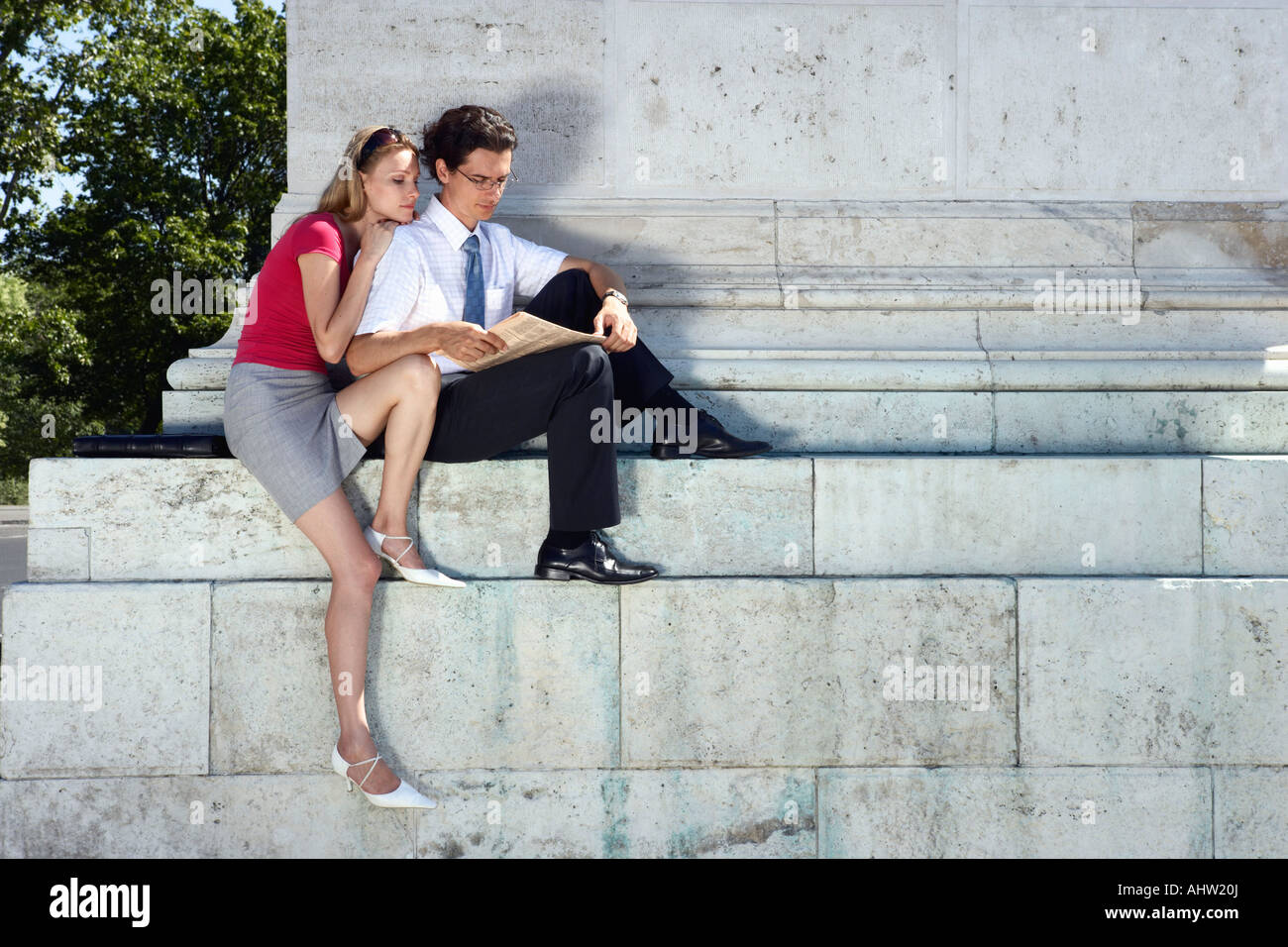 Couple relaxing in Hero Square. - Stock Image