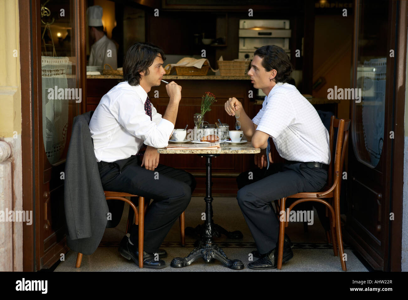 Businessmen having a coffee. - Stock Image