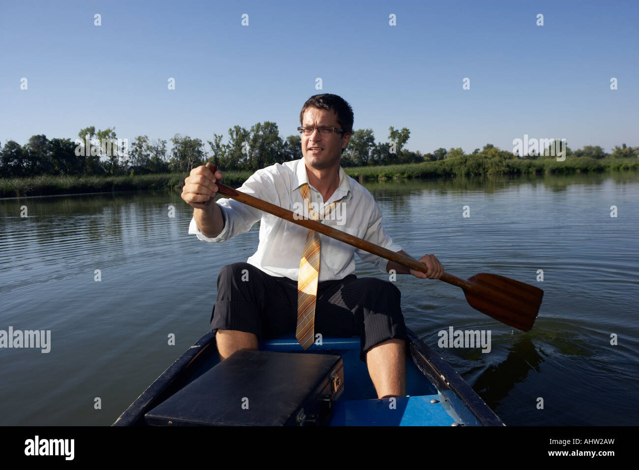62744887fe Businessman rowing in canoe Stock Photo  14548704 - Alamy