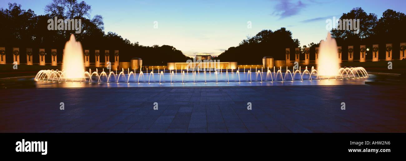 U S World War II Memorial commemorating World War II in Washington D C at night - Stock Image
