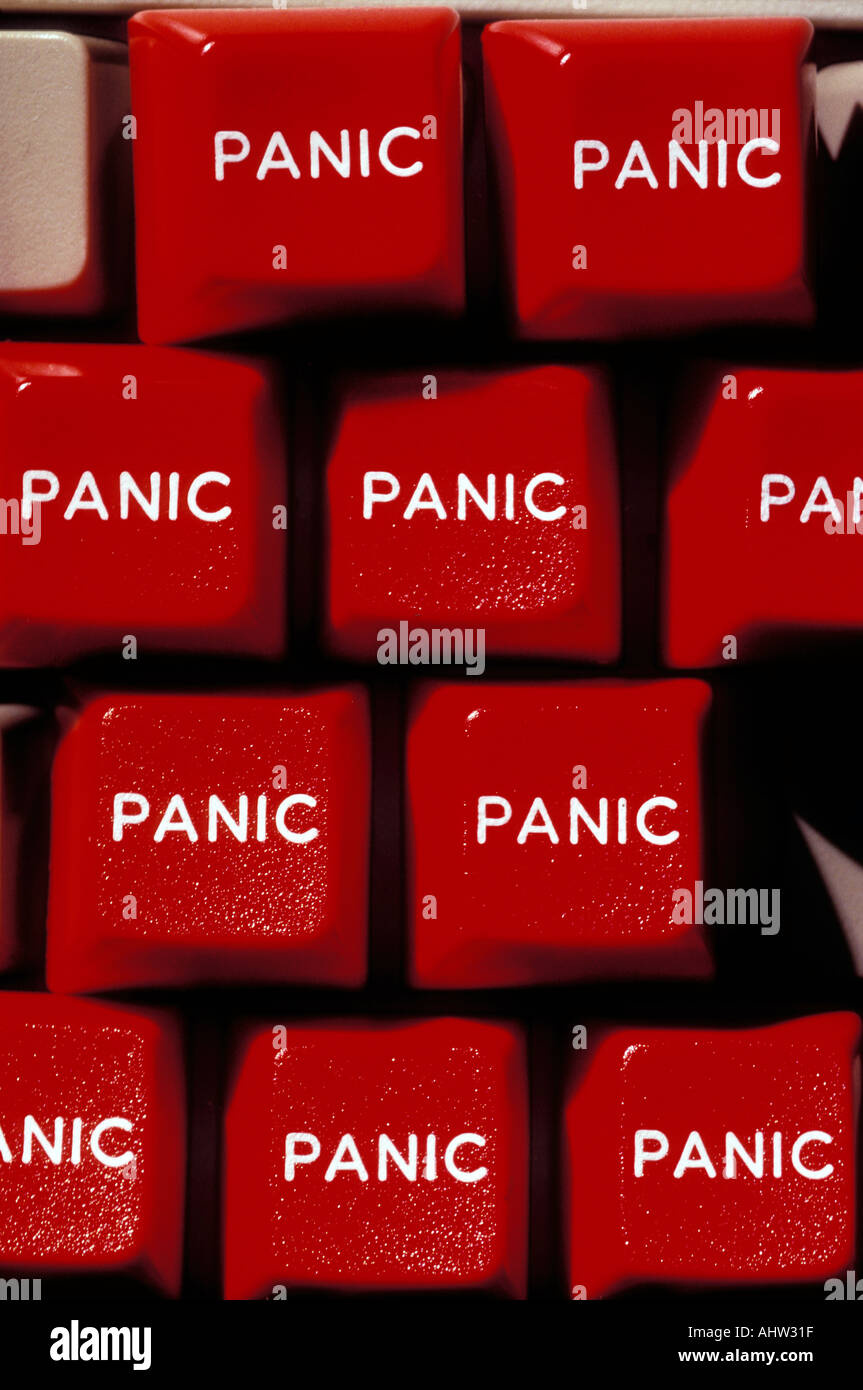 Red panic buttons on computer key board Stock Photo